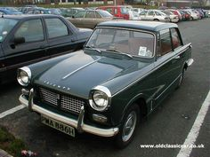 Triumph Herald 1250.  I don't know if mine was a 1250, but it was Battleship Grey and always had a flat battery.  I loved it.