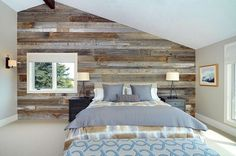 Bedroom with rustic reclaimed wood plank wall and contemporary furnishings. | Contemporary Ranch by Bruce Johnson & Associates Interior Design
