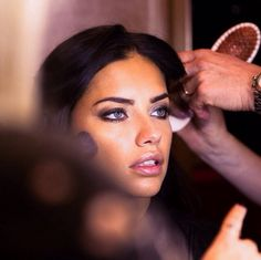 Adriana Lima in hair and makeup