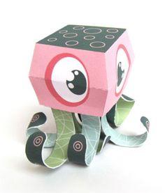 C'est en travaillant sur des modèles pour le livre Papertoy Monstersque l'artiste Marshall Alexander a expérimenté quelques concepts autour des tentacules. Des croquis qui lui ont ensuite servi pour réaliser ce papertoy 'Octobert', joli mollusque de papier aux grands yeux……