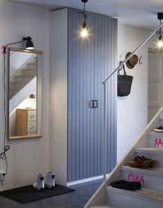 "No closet in the hallway?  PAX wardrobes, available in a shallow 14"" depth, are the next best thing."