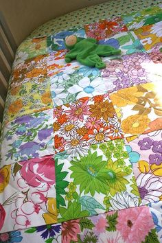 a quilt made from funky floral vintage sheets...these can be had for a song at a thrift store.  A great summer-weight quilt.