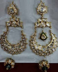 The Jewellers / Manufacturers from Gujarat-Ahmedabad dealing in Real 22k Gold, Royal Kundan Minakari Jadau Jewelry which comes with real flatcut diamonds, different kind of real pearls and different kind of real gems with varieties of Mughal Art, Nizam Art, Victorian, Rajputana, Chitraai, Chilaai, Traditional, Typical & Antique Indian Jewelry and many more.