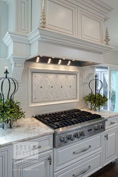 Drury Design |Pinned from PinTo for iPad|. French country kitchen white, with amazing white range hood