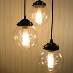 Source:  The Lamp Goods || Kellitown. Clear Seeded Chandelier Trio.  The electrician just hung them.  They are even more beautiful than in the picture!