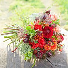Celosia + Zinnias + Bells of Ireland = A vibrant red, wedding bouqet that pops against any wedding white.