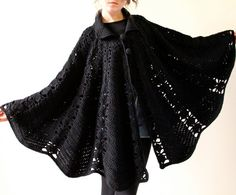 Black but certainly not boring, this vintage hand crocheted cape from the 60s – 70s has a heavy aura of hippie style that's also appealingly modern at the same time. Striking in a minimalist, austere way, the hipster credibility of this cozy shawl seems to transcend its humble boho