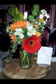Floral arrangement by Nancy and Maggie Rolison (Byron Colby Barn).