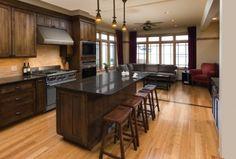 walnut cabinets and dark countertops