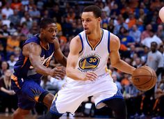 Description of . Golden State Warriors guard Stephen Curry (30) shields the ball from Phoenix Suns guard Brandon Knight in the second quarter during an NBA basketball game, Monday, March 9, 2015, in Phoenix. (AP Photo/Rick Scuteri)