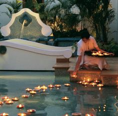 floating candles in your pool. a must while entertaining outdoors i the evening.
