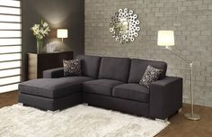Kamea Collection Sectional Sofa He-9677With a size that is in contrast to the expected elements of contemporary design, the Kamea Collection provides your living room with a break from the ordinary. Wide arms flank the sofa-chaise in this modern seating offering and black fabric provides a trendy twist. The chaise provides a welcoming platform for your downtime.Finish: Black PolyesterDimensions:41.5 x 65.5 x 36.5H