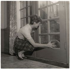 "sophieandbrianna: ""Jackie attempting to get Gaullie's attention through the door, circa early 50's """