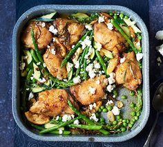 Cut the cost of a chicken dinner with thighs and be rewarded by juicy meat and crispy skin in this dish with asparagus, courgettes, peas and feta