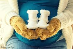 Winter maternity photo shoot, love the cute little baby boots.