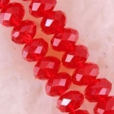 '4x6mm Red Swarovski AB 100 crystals' is going up for auction at  9am Tue, Sep 4 with a starting bid of $3.