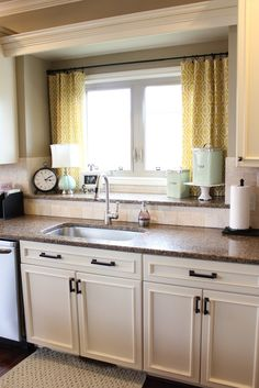 Nifty Kitchen Window Treatment Idea; also LOVE the double window-sill for storage/decor over the sink! #window #treatment #ideas