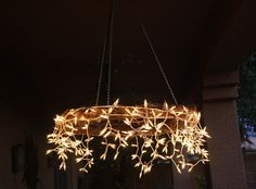 I saw this project on Pinterest. A chandeliermade from a hula hoop and a string of icelcle lights. Instead I used a grapevine wreath...