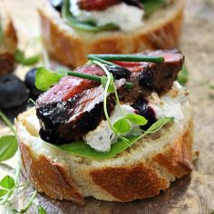 Grilled peppercorn steak atop herbed, whipped goat cheese with blueberry balsamic glaze and fresh chives crostini.