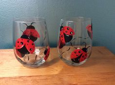 stemless wine glass with Lady bug design. Hand painted by Vino & Vernici.
