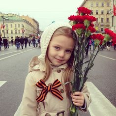 Little Russian girl with flowers