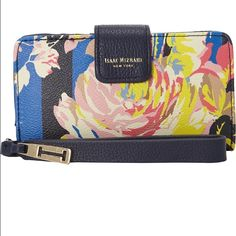 Isaac Mizrahi Cybil Tab Wristlet BNWT Wristlet with tab snap closure Lined canvas wristlet with tab snap closure Gold tone hardware Wristlet strap Within mobile phone pocket Within bank card slots✅ offers ❌trades bundles 20% 2+ Isaac Mizrahi Accessories