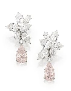 MAGNIFICENT PAIR OF PLATINUM, FANCY PINK DIAMOND AND DIAMOND PENDANT-EARCLIP. Set with two pear-shaped Fancy Pink diamonds weighing 5.79 and 5.68 carats, suspended by clusters of round, pear and marquise-shaped diamonds weighing approximately 19.25 carats; pendants detachable. [And they can be yours for a cool 3.5-4.5 million USD, what a bargain! Let me whip out my credit card!]