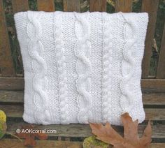 My grandmother is out getting the yarn for this right now! We'll be making euro size cable knit pillows for my bed. ; )   Free pattern!