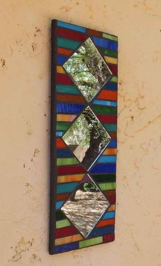 This colorful mosaic mirror measures 13 X 5 It's made with stained glass and backed with hardibacker board. It's safe for outdoors, or even for your shower! It's grouted, and sealed and comes ready to hang. Stained Glass Mirror, Mirror Mosaic, Mosaic Diy, Mosaic Crafts, Mosaic Projects, Stained Glass Projects, Mosaic Glass, Mosaic Tiles, Glass Mirrors
