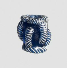 Blue glass barrel-shaped bead, blue and white collar at each end and vertical ribs.