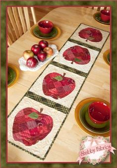 "Patchwork Apple Tabler Runner Kit: Create this darling apple table runner with the Patchwork Apple Table Runner Kit! This Shabby Fabrics Exclusive was designed by, sewn and photographed by Jennifer Bosworth. The runner finishes to 12 1/2"" x 541/2"" and features four patchwork apples, stems, leaves and just a touch of embroidery. Kit includes pattern, all top fabrics, BACKING, and embroidery floss!"