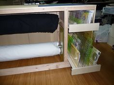 cutting table with storage for batting rolls and rulers!!! whooo looks so good