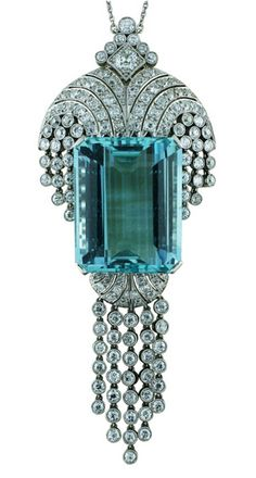 https://www.bkgjewelry.com/sapphire-ring/448-18k-yellow-gold-diamond-blue-sapphire-cocktail-ring.html Art Deco Platinum pendant with a large Emerald Cut Aquamarine, totaling 53.34 carats. It also has very fine well matched diamonds, totaling 7.5 carats and a platinum chain interspersed with diamonds. Made in England, circa 1930's