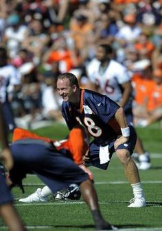 Denver Broncos quarterback Peyton Manning stretches during the opening session of Denver Broncos NFl football  training camp in Englewood, Colo., Thursday, July 26, 2012. (AP Photo/Jack Dempsey)