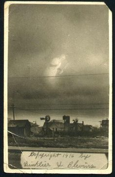 A photo taken in 1916 of an approaching storm. It seems to show a Grim Reaper-like ghost in the sky.