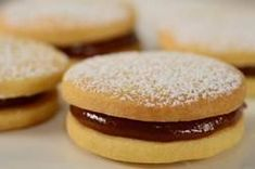 Alfajores - two buttery crisp shortbread cookies and sandwich them together with a sticky and gooey caramel-like filling (Dulce de Leche). I first discovered these in Argentina. My Recipes, Sweet Recipes, Cookie Recipes, Dessert Recipes, Favorite Recipes, Drink Recipes, Baking Recipes, Sandwich Cookies, Cake Cookies