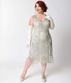 Sweet, sophisticated and undeniably sultry, The Plus Size Bosley silver beaded flapper dress from Unique Vintage is a true vintage recreation with a modern edge. Whether youre looking for a unique dress for prom or homecoming or a perfectly retro frock t 1920s Fashion Dresses, 20s Dresses, 1920s Dress, Unique Dresses, Formal Dresses, Beaded Fringe Dress, Beaded Flapper Dress, Wedding Dresses Plus Size, Plus Size Dresses