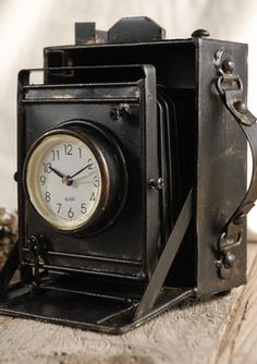 """19.00 SALE PRICE! Metal Case Camera Clock 6x6.. Metal case. 6"""" tall x 6"""" wide x 5"""" deep. Working clock. The side features a metal strap. Bat..."""