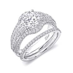 Engagement ring (#LC5444) This engagement ring is the ultimate statement of glamour, with four rows of diamonds in the band. The outer two rows of diamonds contour the center  stone, adding a sleek, refined design element. A matching diamond band finishes the look.
