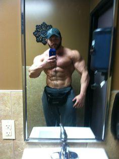Massive hunk fills up the mirror!