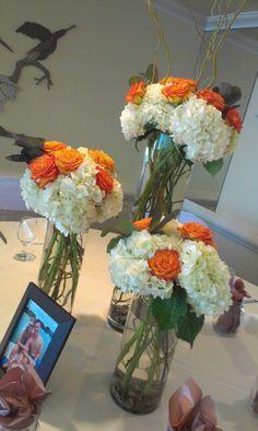 White and orange wedding centerpeices