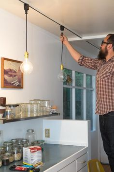 Track lights turned exposed bulb look - attach an adapter to each fixture on the track and then simply plug in the new pendant lights.