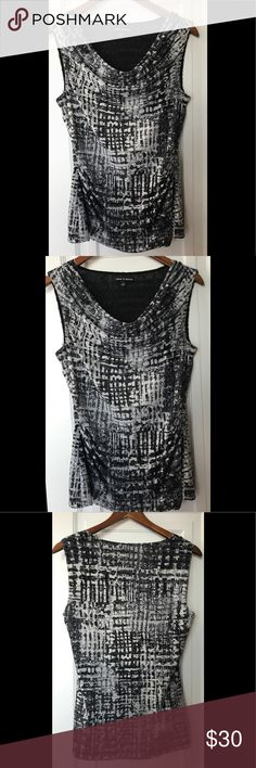 """🆕Cable & Gauge Black/White Sleeveless Top 🆕 { Cable & Gauge Black/White Sleeveless Top }🔥  This FLAWLESS """"Cable & Gauge"""" Black & White Patterned Blouse is SO HOT right now!! With a Draped Neck, sexy fit, & fun textile print you'll be sure to catch EVERYONE'S attention💋    💥Perfect for this season!💥  💛 You can wear this SO many ways, I choose to model this in a few different ways for sexy work attire ;)   You could also dress this ⬇️ w/ dark, cropped skinny jeans, flats or booties & a…"""
