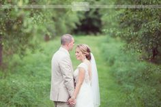 Bride and groom photos in the apple orchards behind the Smith Barn wedding venue in MA.  This is the best rustic wedding venue!  It's close to Boston, but feels super woodsy, and has a lovely red barn for the reception!  #smithbarn #appleorchard #brideandgroom