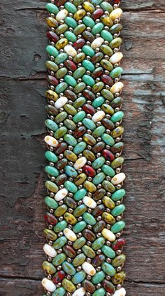 Herringbone stitch with Picasso finish 2-hole seed beads. Created at Beads 'N Things in Pittsford, NY. www.beadsnthings-ny.com