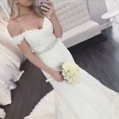 This beautiful all-over Lace fit and flare wedding gown features sparkling Diamante beading throughout and romantic cap sleeves. Comes in ivory or white Lace over a variety of Dolce Satin underdress color choices.•