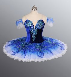 Odile Ballet Tutus and Dance Costumes  I like how this Odile isn't black, but instead dark blue