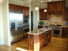 My kitchen to be! Cherry Cabinets with Hickory Floors! Blue walls though. LOVE
