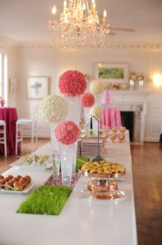 Tall balls of carnations as decor for a wedding or bridal shower.
