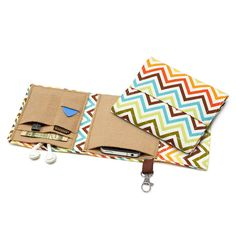 Earthy Desk Accessories to Fall For: Transferring all your necessary gizmos from one bag to another (and in and out of your desk) can be a real hassle. The Chevron Nerd Herder Gadget Wallet ($36) adds some pizzazz with earthy Fall colors while securing your cell phone, USB drive, SD card, office key card, earbuds, and more.